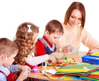 Kindergarden teacher with group children.